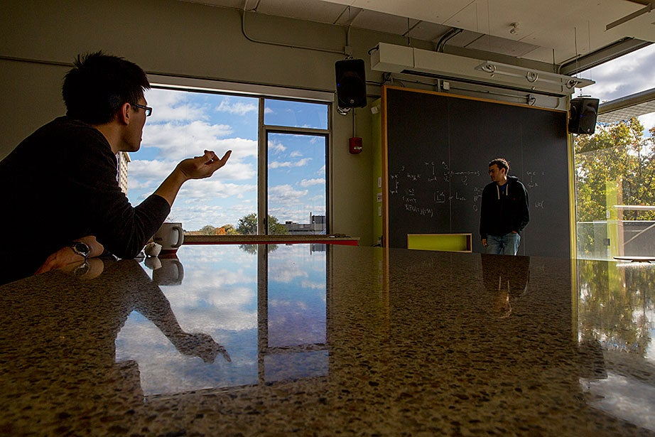 Zijian Yao, a Ph.D. candidate in mathematics, offers insight to fellow candidate Jeremy Hahn.