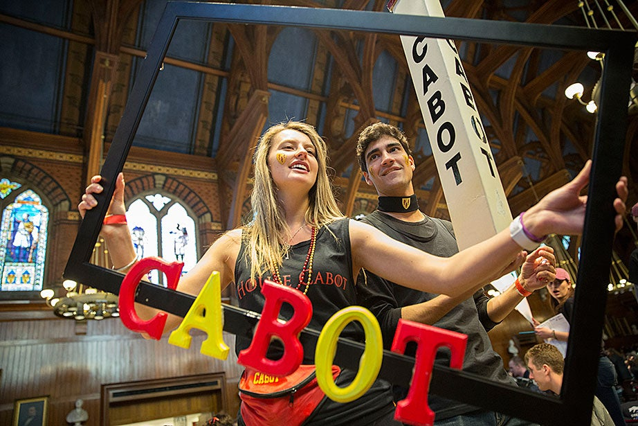 Sarah Chapman '18 and Pietro Galeone '17 boost Cabot House while students celebrate Housing Day inside Annenberg Hall. Kris Snibbe/Harvard Staff Photographer