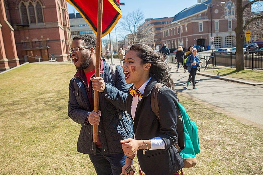 Adams House residents Christopher Johnny '18 (left) and Tasnim Ahmed '17 welcome students to their House while celebrating Housing Day at Annenberg Hall. Kris Snibbe/Harvard Staff Photographer
