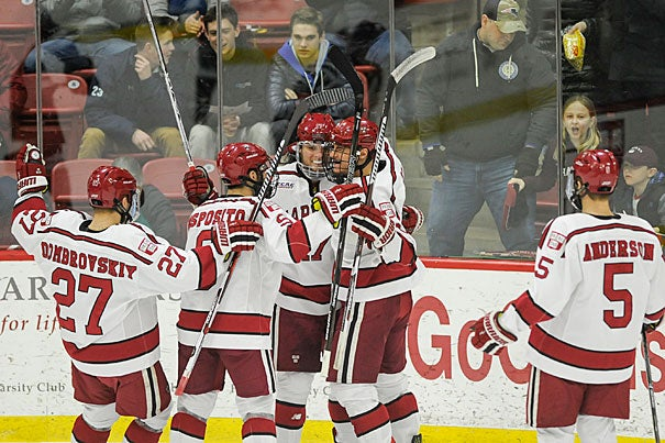 Crimson forward Sean Malone '17 (center) is surrounded by teammates after scoring Harvard's first goal of the game on Friday.