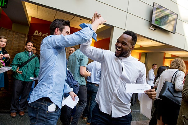 "Chijioke Nze (right) said he was elated when he found out he and friend Aaron Cohen would be heading to Brigham and Women's Hospital together next year. ""He was the first person I met at HMS,"" said Nze. ""We went on our first interviews together."""