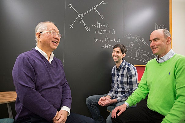 Shing-Tung Yau (from left), William Caspar Graustein Professor of Mathematics, Ben Allen, researcher at the Program for Evolutionary Dynamics (PED), and Martin Nowak, PED director, are co-authors of a new study that examines how cooperation emerges in social networks and debuts an algorithm that can calculate the likelihood that a network will foster cooperation.