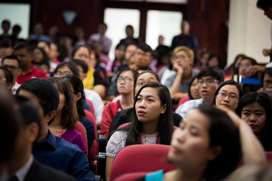 Audience members listen to Drew Faust, a historian of the American Civil War, speak at Ho Chi Minh City University of Social Sciences and Humanities, offering her audience an at-times personal view of the Vietnam War and how it affected her and others of her generation.