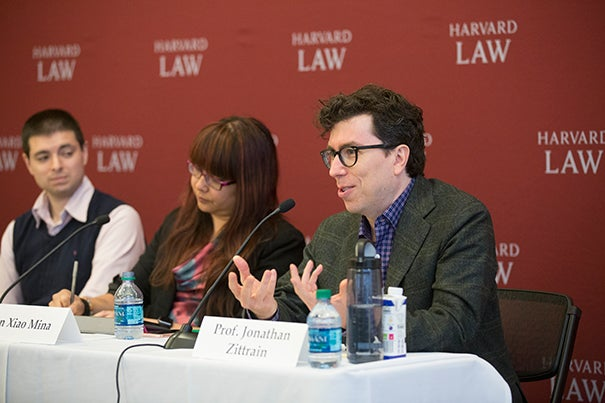 "At a panel discussion at the Berkman Klein Center on the pervasiveness of fake news, Jonathan Zittrain (right) said that people have lost faith in the credibility of the ""mainstream news"" while the abundance of sources that cater to preconceived notions have made it ""hard to tell the reliable stuff from the nonreliable stuff."" Fellow An Xiao Mina and MIT Ph.D. candidate Nathan Matias (left) listen on."