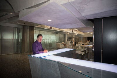 David Myers stands at the new Coffee Bar, one of many futuristic renovations in the Cabot Library.