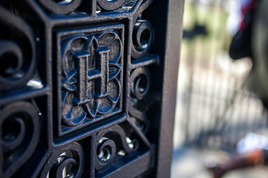 Bradstreet Gate, North, honors the presence of women on campus. It was dedicated to Anne Dudley Bradstreet, the first published poet of the American colonies, in 1997, the 25th anniversary of women living in the Yard's dormitories. The picture shows a detail on one of the wrought-iron side columns.