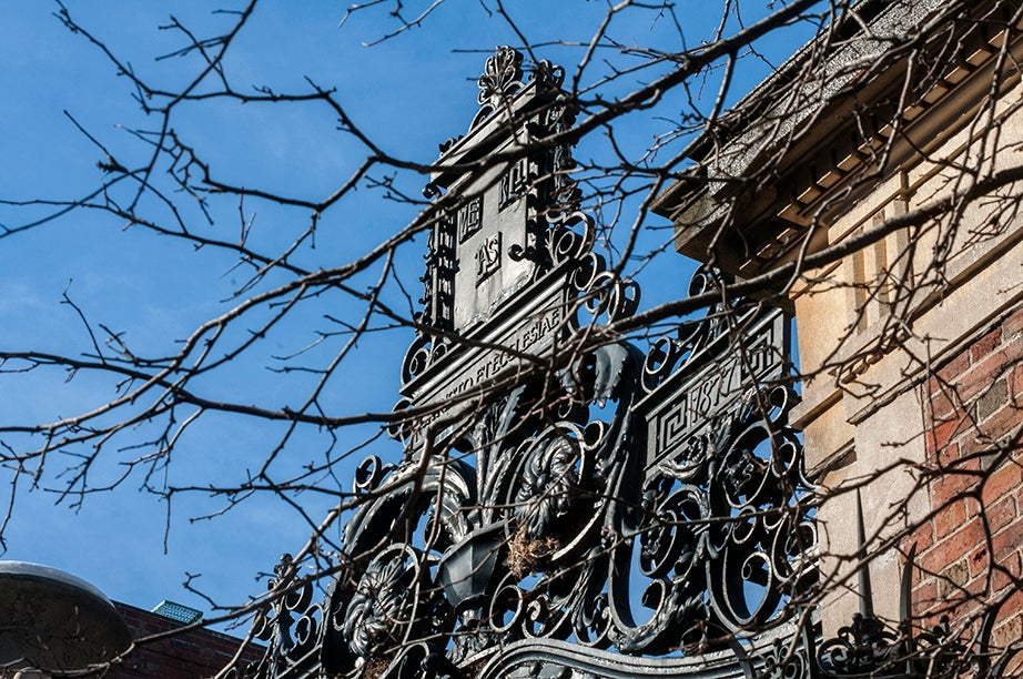 Morgan Gate (Class of 1877), South. Architects McKim, Mead & White planned this gate to serve as a portal at the end of a grand axis connecting the Yard to the Charles River. The project was never developed, and the majestic gate now serves as an entrance to Widener Library.