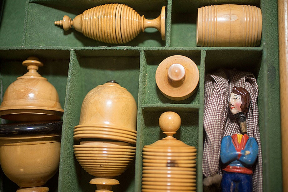 "Detail of containers and a puppet used in ""The Little Conjurer"" magic set."