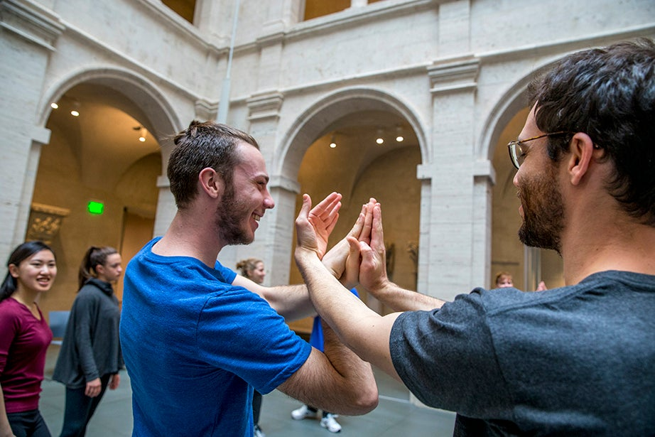 "William Forsythe created ""Catalogue (First Edition),"" which is staged without music, for Dance On, Christopher Roman's Berlin-based company of dancers who are more than 40 years old. Younger participants Marvin Merritt '20 (left) and Adi Snir, Ph.D. candidate, work to perfect their hand movements. Rose Lincoln/Harvard Staff Photographer"