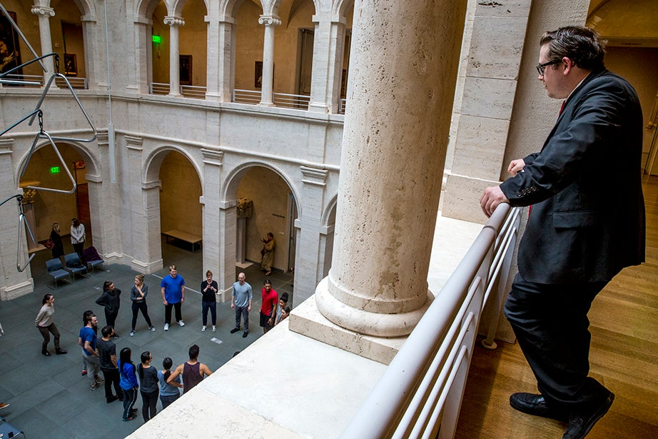 Security guard Charles Popp looks down on the Calderwood Courtyard. Rose Lincoln/Harvard Staff Photographer