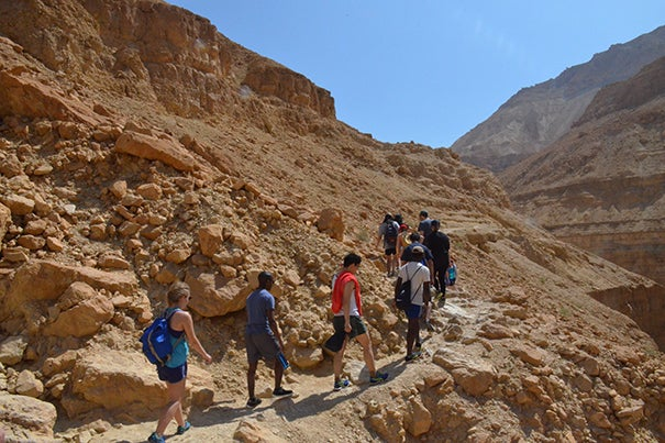 Harvard students trek up the rocky hillside along the banks of the Nahal Arugot (Nahal River). The hike can take up to four hours.
