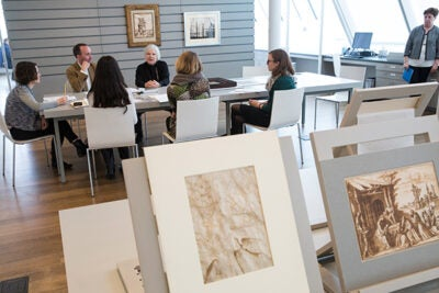 Director of the Harvard Art Museums Martha Tedeschi (center) sits in on a graduate workshop led by Edouard Kopp (second from left), Maida and George Abrams Associate Curator of Drawings, that ventured to Paris to help choose new acquisitions for the Museums.