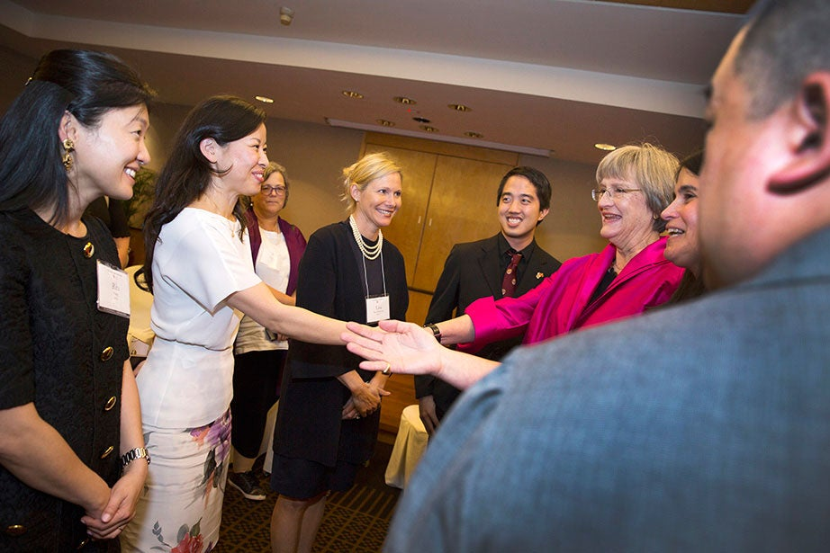 """President Faust attends the Asia Club Leaders Reception and meets with alumni before the """"Your Harvard: Singapore"""" program in March 2017.  Faust has engaged with alumni across the globe throughout her presidency; Harvard has more than 300,000 alumni living in 200 countries. Stephanie Mitchell/Harvard Staff Photographer"""