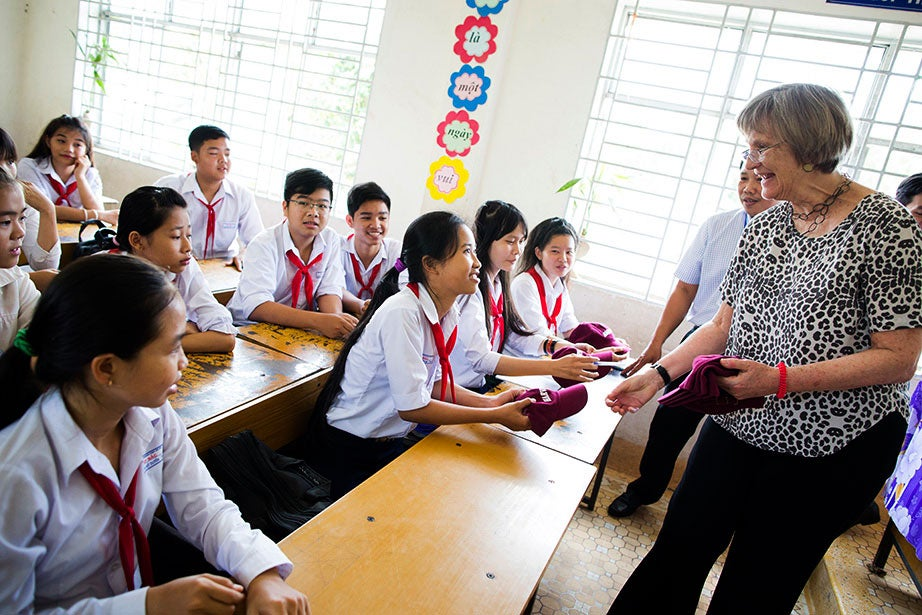 In Vietnam, President Faust visits Ap Bac Secondary School, Tan An Hamlet in Cai Lay Town, Tien Giang Province, and gives out Harvard baseball caps in March 2017. Faust also gave remarks on war and its aftermath at the Ho Chi Minh City University of Social Sciences and Humanities, and met with leaders at the Fulbright University Vietnam. Stephanie Mitchell/Harvard Staff Photographer