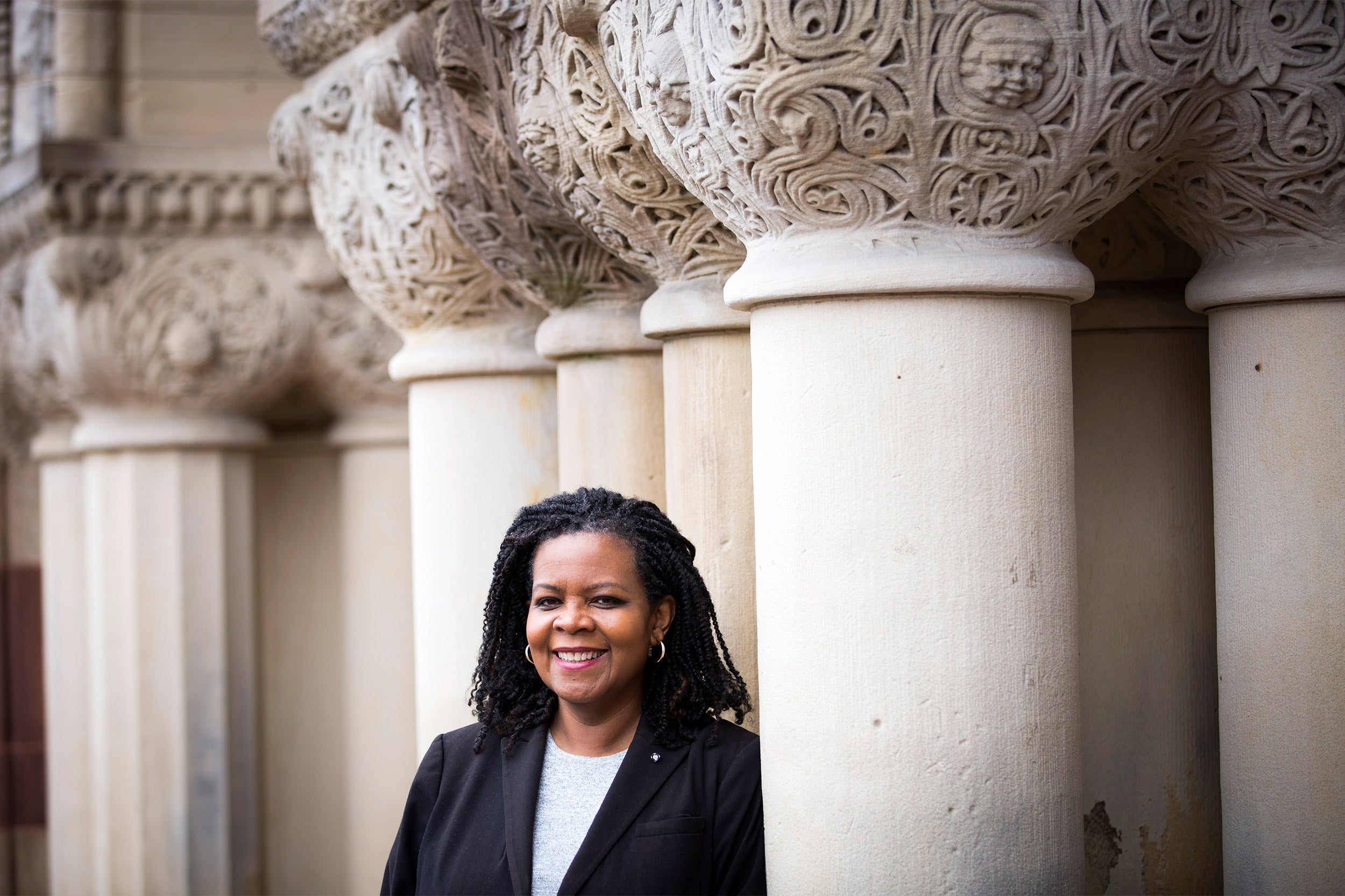 Annette Gordon-Reed standing by columns.