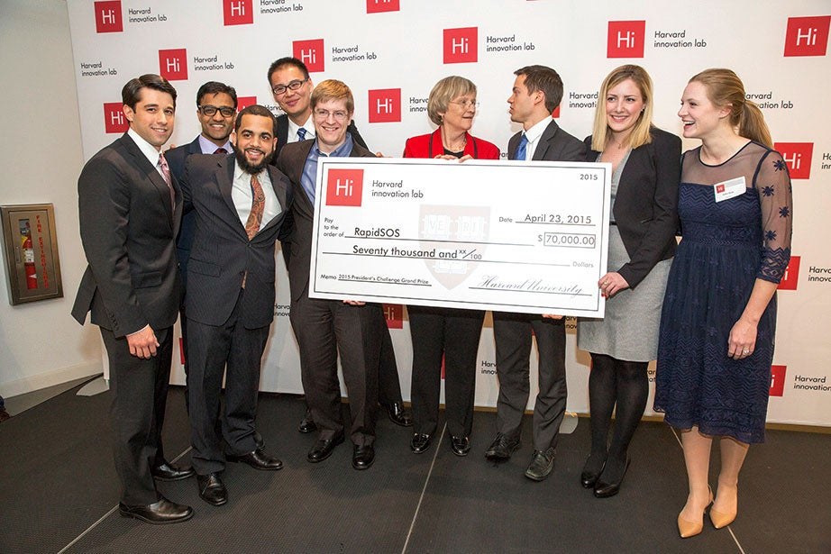 President Faust awards the winners of the President's Innovation Challenge, RapidSOS, in 2015. The President's Innovation Challenge presents Harvard students with an opportunity to engage with and work to address issues facing the world in areas such as education, health, energy, and the environment. Since it was established in 2012, the President's Challenge has awarded $1.94 million to 58 winners who have gone on to raise $97 million to further advance their efforts. Jon Chase/Harvard Staff Photographer