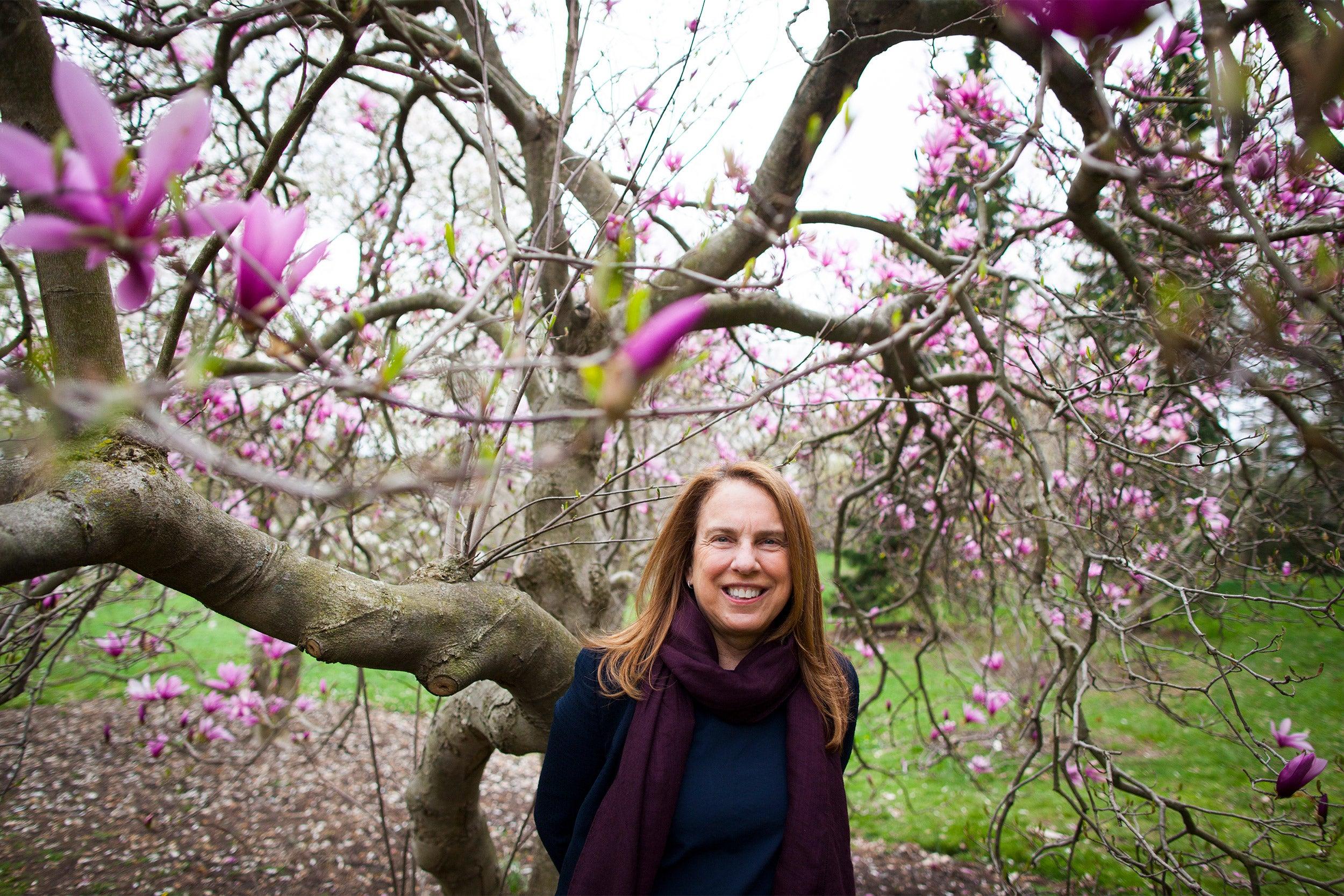 Pamela Silver by a flowering tree.