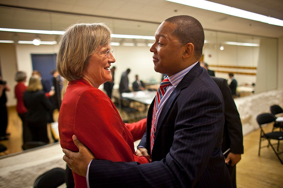 Drew Faust greets celebrated Jazz musician Wynton Marsalis at Sanders Theatre in 2011, kicking off a two-year lecture and performance series to illuminate the relationship between American music and the American identity. Early in her presidency, Faust set a course to put the arts—in all forms—at the center of University life, including connections between arts activities and science, technology, humanities, and other fields. Photo by Justin Ide