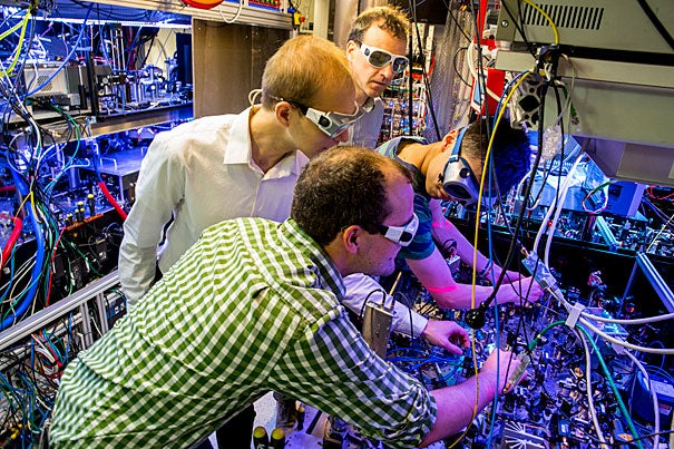 Physics Professor Markus Greiner (in back) and his team — Anton Mazurenko (from left), senior grad student, Daniel Greif, postdoc fellow, Geoffrey Ji, graduate student, and Christie Chiu (not shown) — have created an antiferromagnet, an exotic form of matter that can give important insights into how room temperature superconductors might be created.