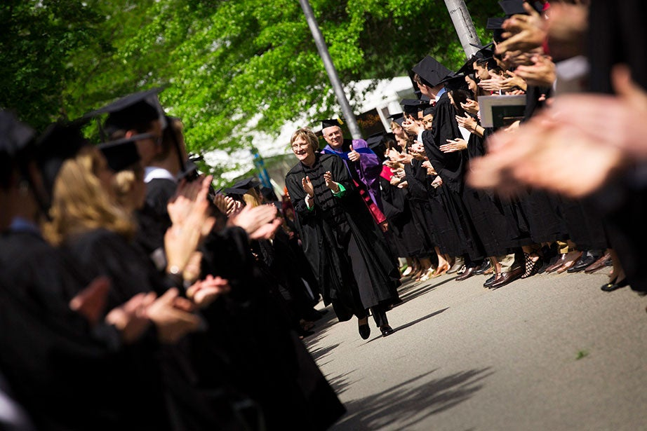 At Phi Beta Kappa Exercises for the Class of 2017, Drew Faust (center) cheers on seniors as they line up to enter Sanders Theatre for the 227th Literary Exercises. Stephanie Mitchell/Harvard Staff Photographer