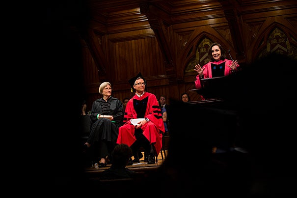 """President Drew Faust (from left) and Robin Kelsey, dean of arts and humanities, listen as Sherry Turkle delivers the oration at the Phi Beta Kappa Literary Exercises. """"Life teaches that presence matters,"""" said Turkle. """"People respond to commitment and deliberateness."""""""