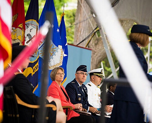 """Harvard President Drew Faust (left) and Gen. John  Hyten at the ROTC Commissioning Ceremony. """"You are receiving your commissions at a moment of extraordinary challenge for our society and the wider world,"""" Faust told the graduates during the ceremony in Tercentenary Theatre."""