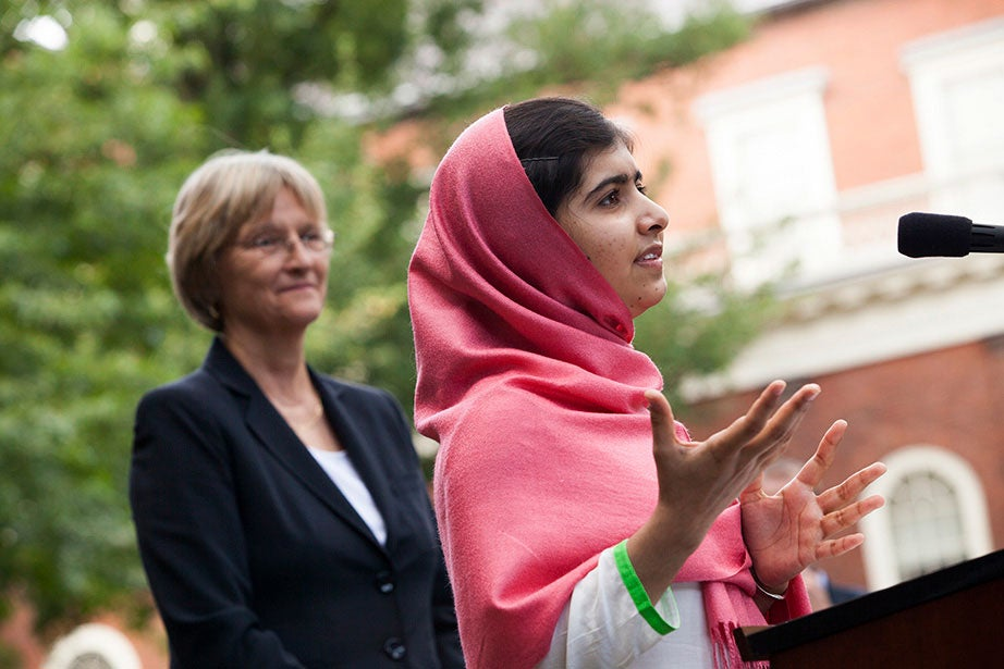 Faust welcomes humanitarian Malala Yousafzai, winner of the 2013 Harvard Foundation Award, to Massachusetts Hall, where they discussed the importance of education for young girls. Stephanie Mitchell/Harvard Staff Photographer