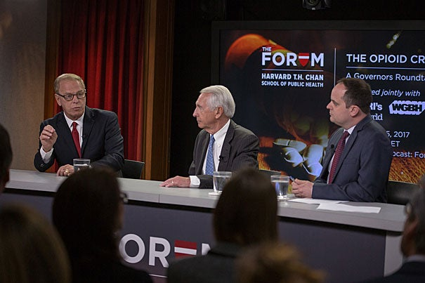 At the Harvard Chan School Forum on the nationwide opioid crisis, former governors Ted Strickland (from left) and Steven Beshear, the Menschel Senior Fellow, called for greater doctor cooperation and increased federal resources. Moderator and WGBH reporter Craig LeMoult led the discussion that was broadcast live on NPR.