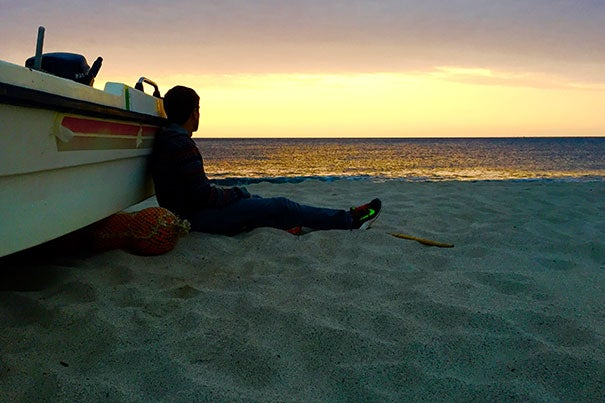Danny Banks '17 watches the sun rise over the Ionian Sea from the Mare Nostrum beach in the resort town Soverato, a town in the Calabria region of southern Italy, where he was doing research for his senior thesis.