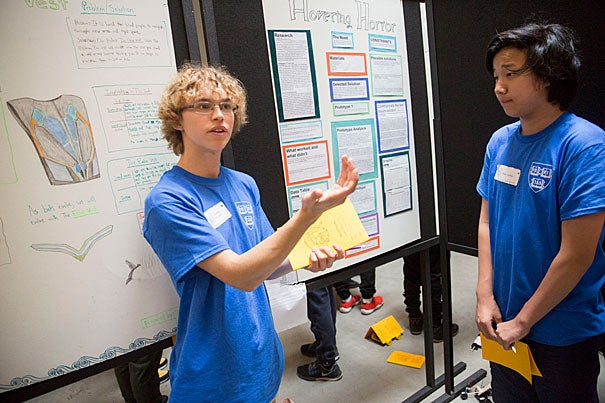 Theodore Woodward (left) of Vassal Lane Upper School presents his science project on an echolocation vest for the blind alongside classmate Peter Leiker during the seventh annual eighth-grade science fair in the Northwest Labs.
