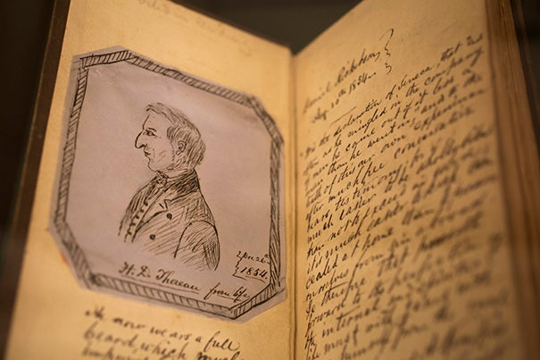 """A Houghton Library exhibit contains ephemera related to poet and scholar Henry David Thoreau, such as this annotated 1854 copy of """"Walden, or Life in the Woods,"""" owned by a friend of Thoreau."""