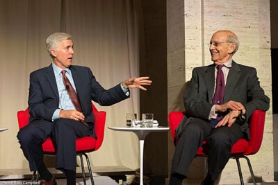 "At the Harvard Marshall Forum dinner, Associate Justices of the Supreme Court Neil M. Gorsuch, J.D. '91 (left), and Stephen Breyer, J.D. '64 stressed the importance of respect for the rule of law and the ""sense that judges can safely decide the law without fear of reprisal."""