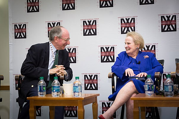 """Sir Malcolm Rifkind speaks to Marshall Medalist Madeleine Albright, former U.S. Secretary of State, at the Harvard Marshall Forum. """"America is stronger when we are part of the global community,"""" remarked Albright."""