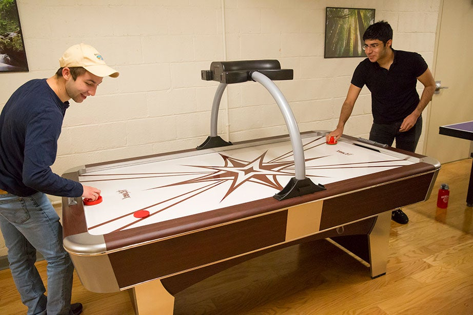 Scott Kall (left) and Soheil Sadabadi play air hockey. Jon Chase/Harvard Staff Photographer