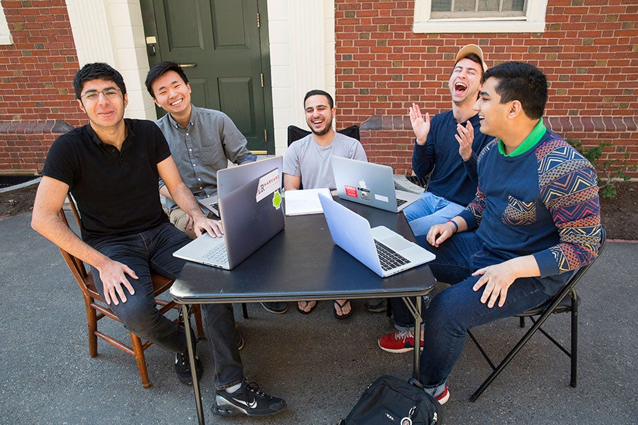 "Roommates in Wigglesworth on what they called their ""porch"": Soheil Sadabadi from Iran (from left), Andrew Cho from Arizona, Michael Shadpour from California, Scott Kall from Massachusetts, and Arpan Sarkar from Tennessee. Jon Chase/Harvard Staff Photographer"