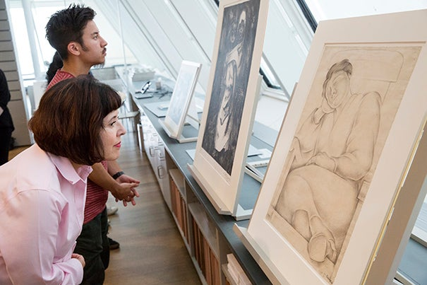 Viondette Lopez of Alexandria, Va. and Extension School student Hazard Ho study drawings by Diego Rivera at the Art Study Center of the Harvard Art Museums.