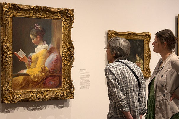 """Harvard Art Museums visitors admire """"Young Girl Reading"""" by Jean-Honoré Fragonard, a highlight of the many loans and exchanges that the museums make with other art institutions."""