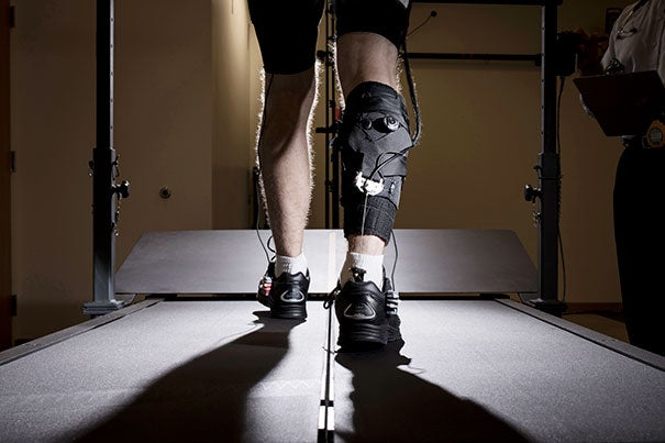 This view of the ankle-assisting exosuit shows its soft robotic elements and the cable that transfers mechanical power from actuators operated from the hip to the ankle joint.