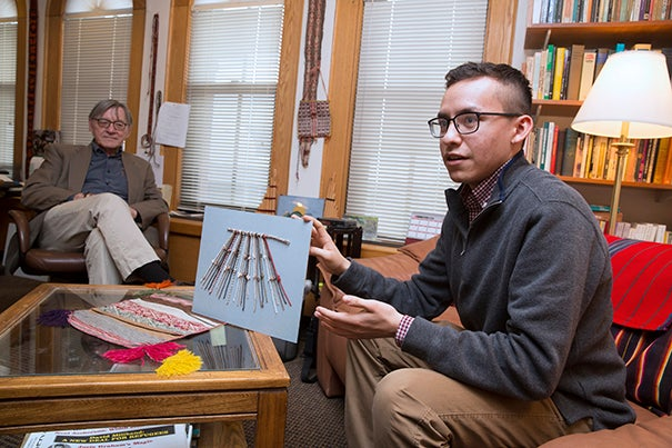 A study by Manny Medrano '19 (from right), with guidance from Professor Gary Urton, has decoded the meaning behind khipus, an Incan bookkeeping method of knotted rope.