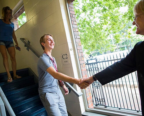 Michael Medaugh '21 meets Harvard President Drew Faust for the first time after exchanging letters six years ago. Medaugh's mother, Stephanie, comes downstairs to join her son.