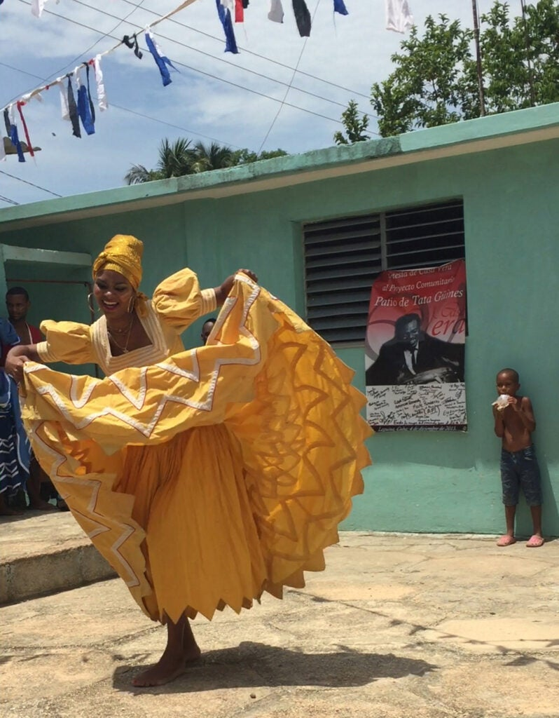 A member of the National Folkloric Company of Cuba dances in theTata Güinesmuseum courtyard.