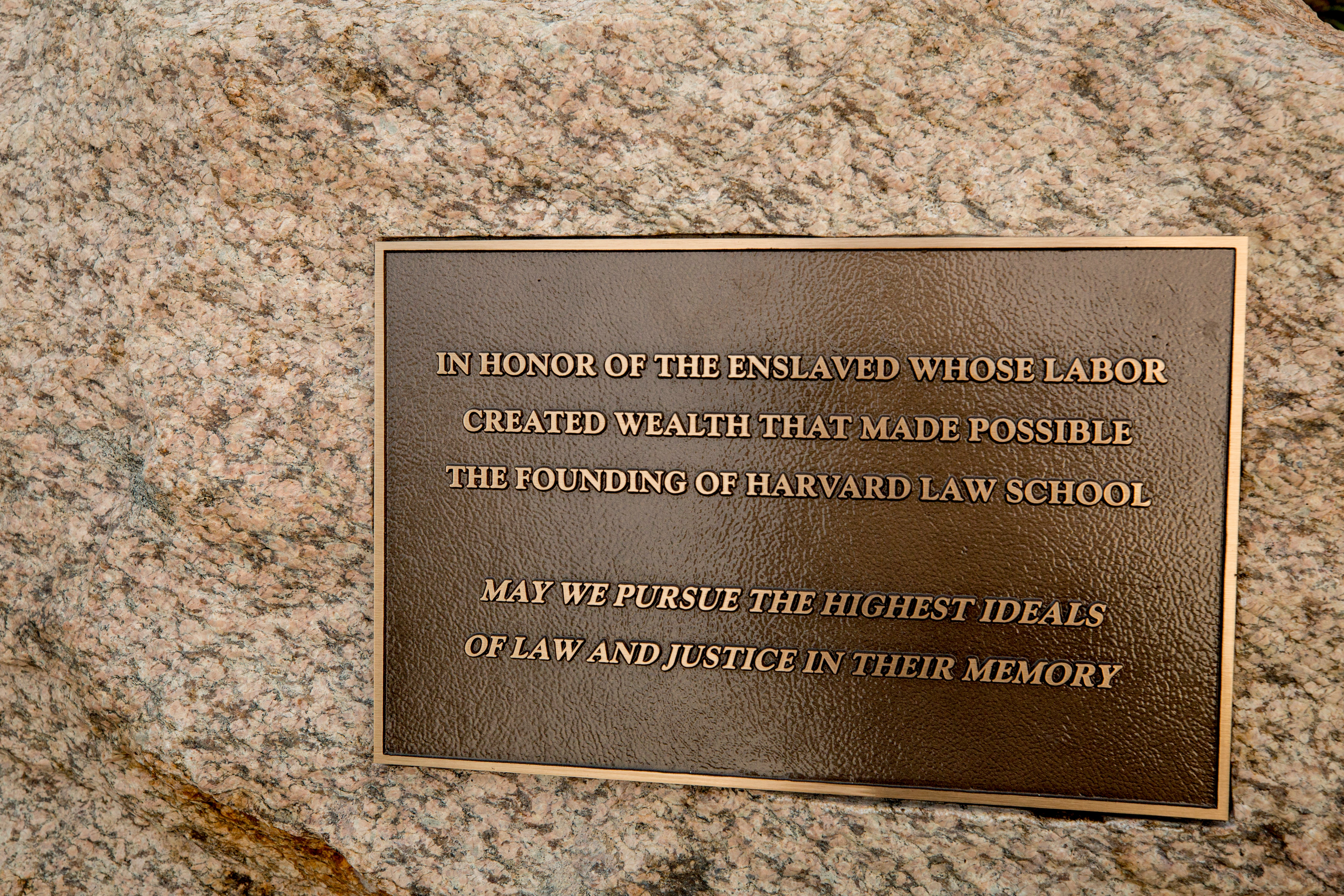Plaque recognizing enslaved people integral to founding of Harvard Law School.