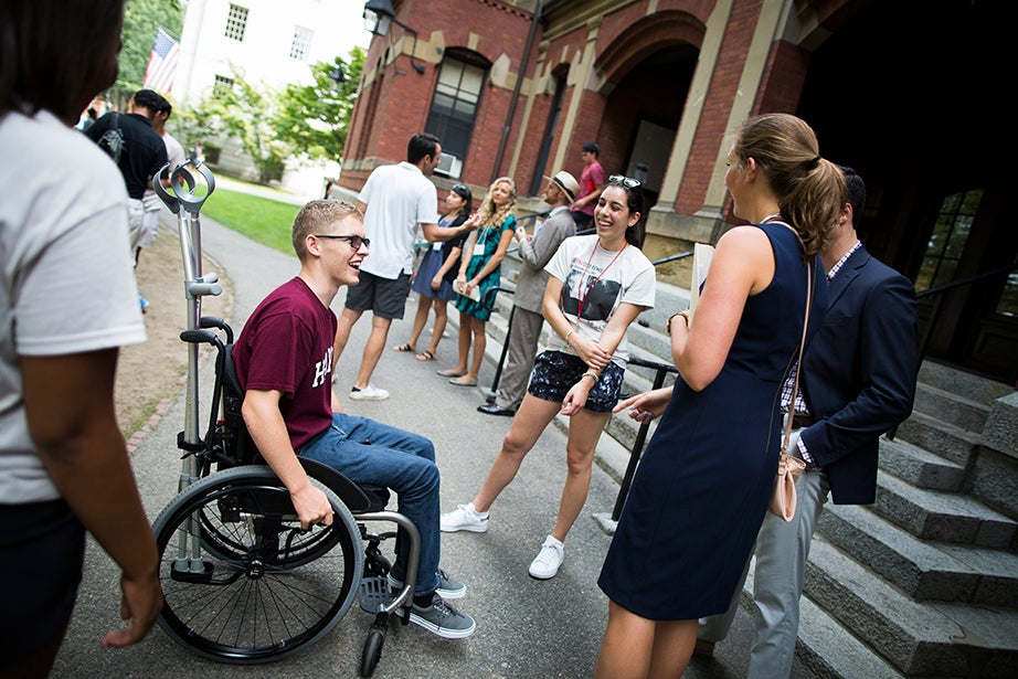 Case Mckinley '21 (from left) meets with Nayiri Ayanian '18, proctor Jon Rossi, and freshman adviser Rachel Brown in front of Weld Hall. Stephanie Mitchell/Harvard Staff Photographer