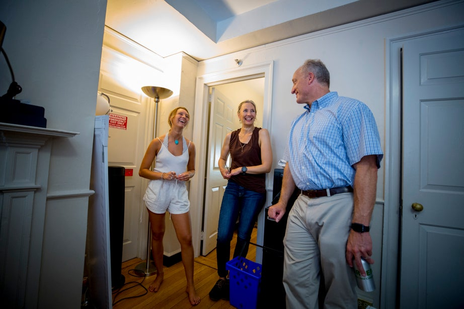 Esme Benson (left) and her mother, Michele Polacsek of Portland, Maine, talk with Dean of the Faculty of Arts and Sciences Michael D. Smith. Rose Lincoln/Harvard Staff Photographer