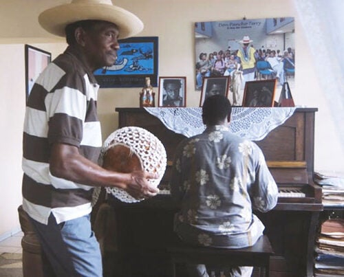 While guiding the Harvard Monday Jazz Band through the vibrant landscape of his native Cuba, Yosvany Terry (at piano) returned to his hometown. His father, Eladio (left), joins him in playing some music.