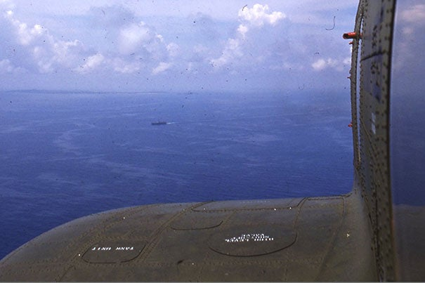 Zarins, who was flown out to the U.S. carrier, captured a shot of the South China Sea while leaning out the helicopter's window.