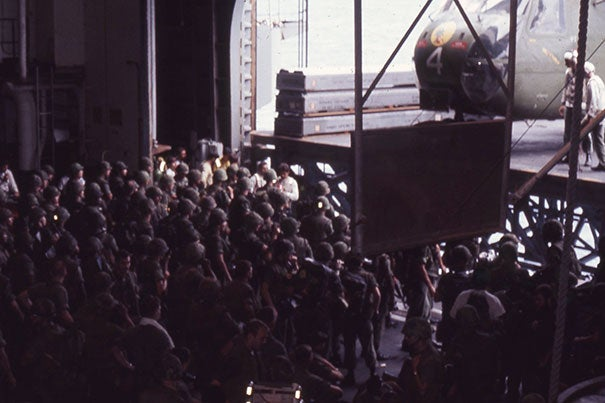 Marines aboard the USS Okinawa preparing to depart for the U.S. Embassy compound to support the evacuation of Saigon.