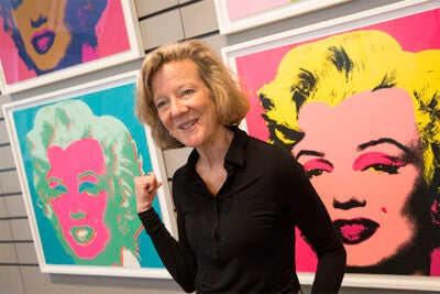 Curator Mary Schneider Enriquez with Andy Warhol silkscreen prints of Marilyn Monroe, at the Harvard Art Museums..Jon Chase/Harvard Staff Photographer.