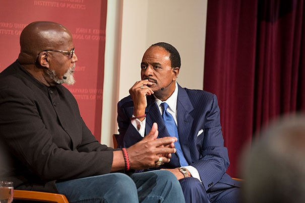 Berkeley Professor Harry Edwards (left) talks with sportscaster James Brown about the history of activism by black athletes and how players such as Colin Kaepernick continue their legacy.