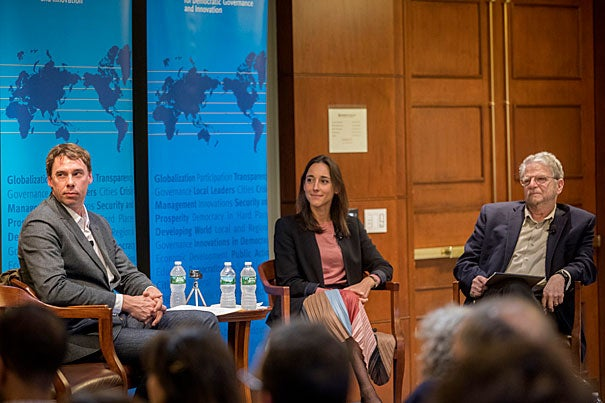 Kennedy School graduates Guillaume Liegey (left) and Brune Poirson discuss their experience guiding Emmanuel Macron to victory just weeks after graduating. Arthur Goldhammer (right) also participated in the event. Kris Snibbe/Harvard Staff Photographer